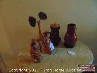 Oriental Figures with Candle, Vase, and Bird House.