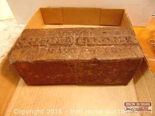 Brick from the Indianapolis Speedway.