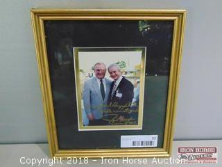 Framed photograph of Humpy Wheeler and Gov. Jim Hunt.