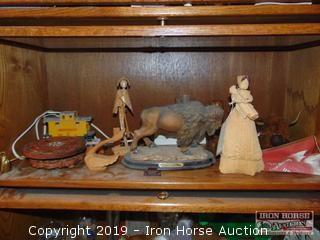 CONTENTS OF SHELF INCLUDING UNION PACIFIC TRAIN, WOOD CARVED FIGURINES, BISON STATUE