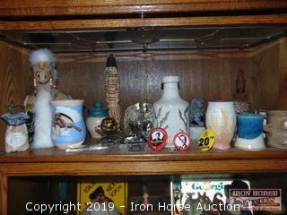 CONTENTS OF SHELF INCLUDING CAMEL JEWELRY BOX, SMALL POTTERY PIECES, FACE JUG, ORIENTAL STATUES
