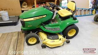 "LX 320 JD Yard Tractor w/ 54"" Mowing Deck"