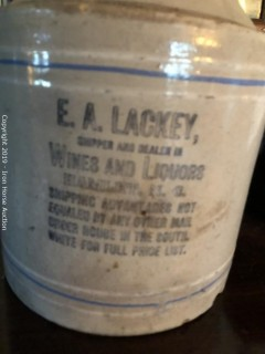 "Earthen Jug w/ Corncob Stopper  -  ""E.A. Lackey Wines and Liquors - Hamlet, NC"" indicated on side of jug"