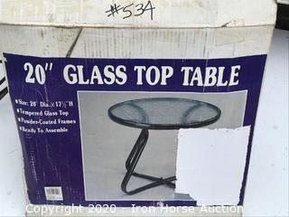 Glass top table, 20 inches diameter x 17.5 inches tall